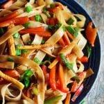 easy thai drunken noodles with vegetables in a ceramic plate