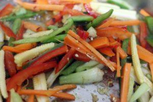 chopped vegetables added to sautéed ginger garlic