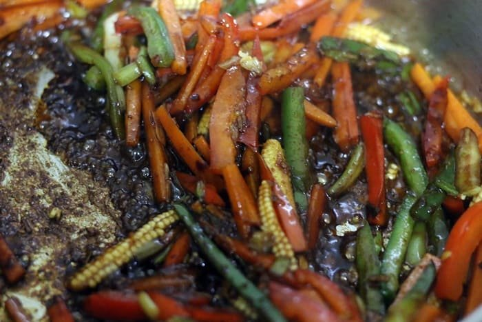 sauce tossed in vegetables over high heat