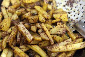 sautéing potatoes in spice powders