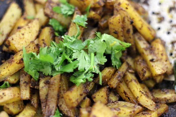 coriander leaves added to potatoes