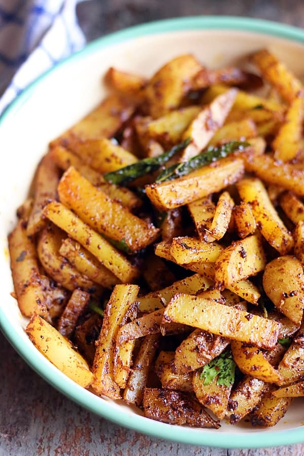 easy vegan achari aloo served hot