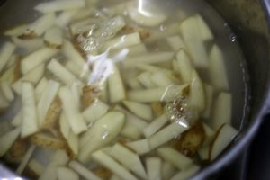 chopped potatoes soaked in water