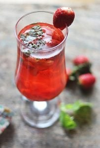 strawberry tea served with fresh berries