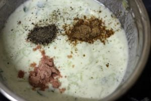 spice powders and salt added for making cucumber raita
