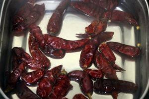 soaking dry red chilies in warm water