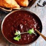 sweet tamarind chutney or imli chutney served with samosa
