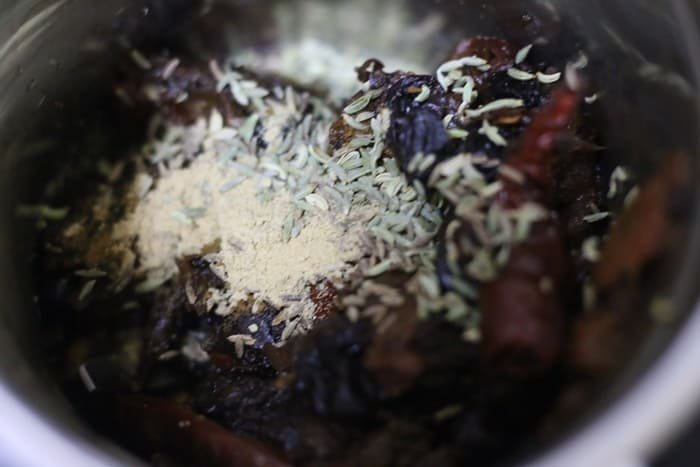 cooked tamarind, dates and spices in mixer grinder jar