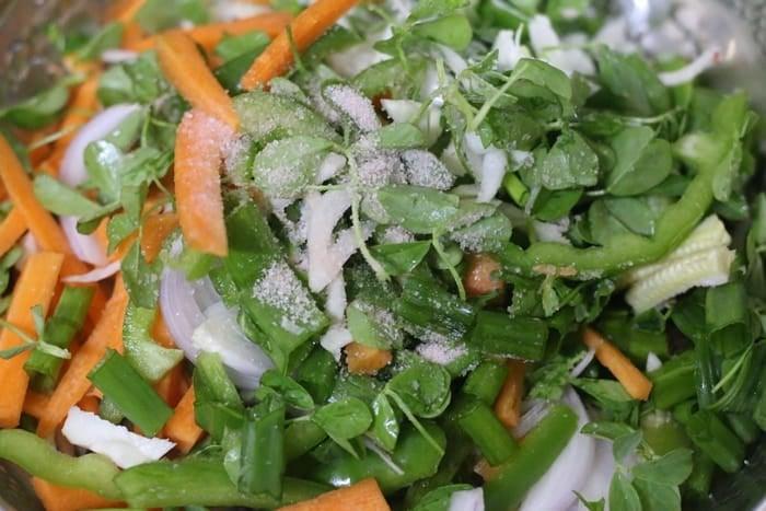 salt sprinkled all over chopped vegetables