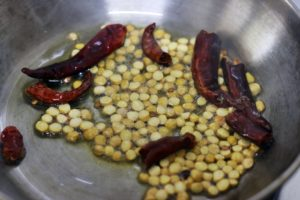 frying chana dal and red chili for chutney