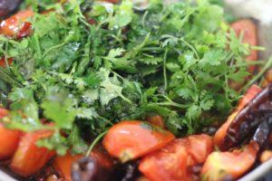 making coriander tomato chutney