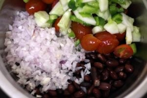 Vegetables and cooked kidney beans in a bowl for salad