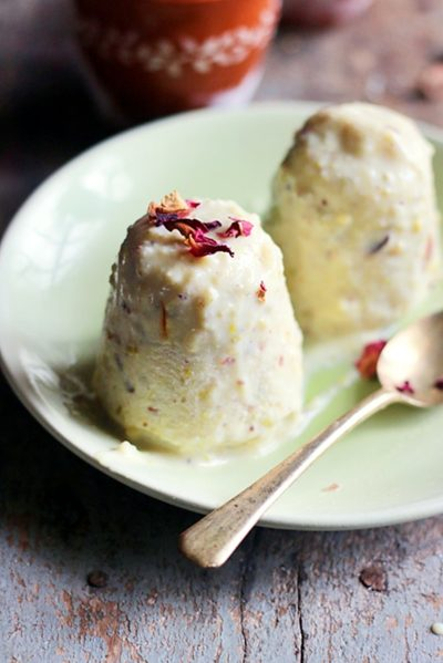 homemade traditional kulfi served in a ceramic plate with a spoon