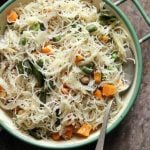 homemade fluffy soft semiya upma served in a enamel rimmed bowl with a spoon