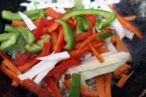 shredded vegetables added to ginger garlic