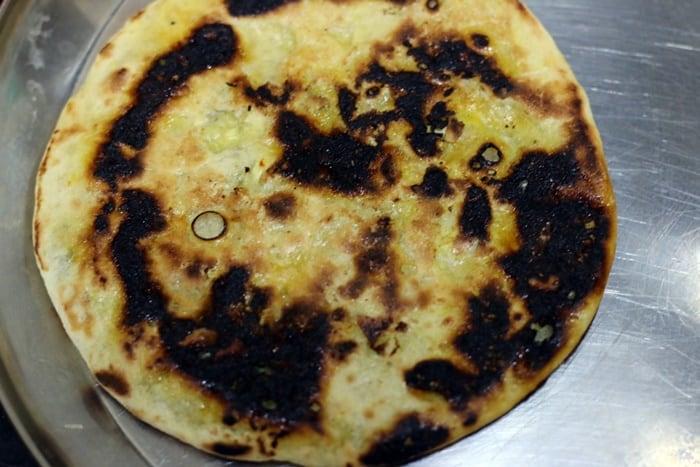 charred and crispy kulchas