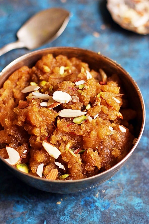 Atta halwa or homemade wheat halwa served in a silver bowl with a spoon