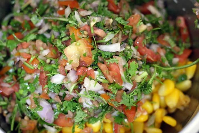 chopped onions tomatoes, coriander leaves & green chillies mixed with boiled corn